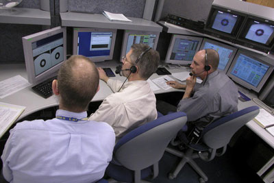 Three control room operators at work