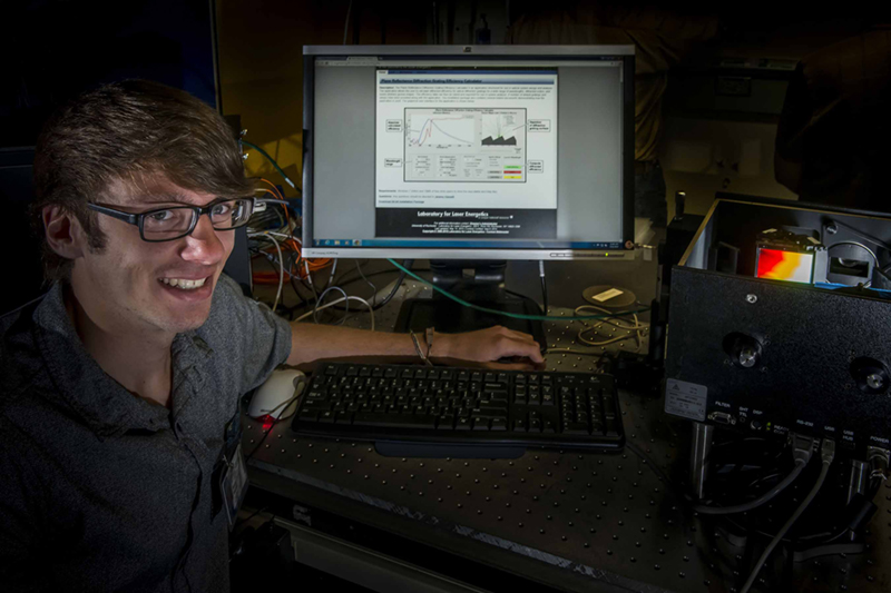 Jeremy Hassett with a software application he wrote to aid engineers and scientists at LLE with diffraction-grating system design and analysis