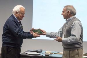 John Soures receiving plaque from Roberto Mancini at OLUG Workshop