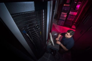 Tony Brancato performing diagnostic tests on one node of the 72-node cluster