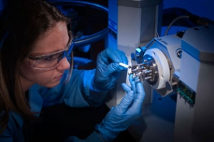 Mackenzie Hall mounting a sample of an adhesive into a dynamic mechanical analyzer