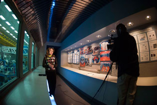 Hubble News Team Visits LLE and filming in hallway