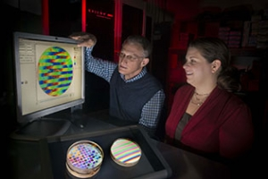 Steve Jacobs and Brittany Taylor examine a color-coded amplitude map