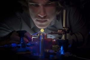 Eric Glowacki, preparing a membrane for testing using a custom-built permeation measurement tool