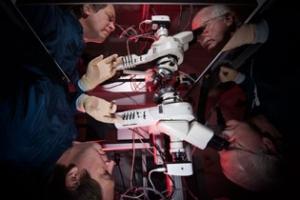 Charles Kellogg and Kevin McGowan examining a prototype diffraction grating