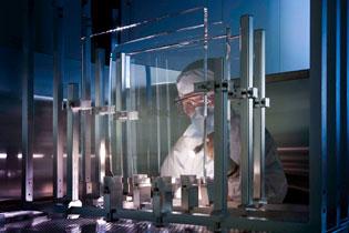 Inspector; vacuum window, focus lens (center), and ultraviolet diagnostic beam splitter (UV DBS)