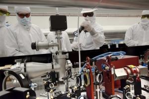 Matt Moore (left) describing the upgrade of the OMEGA EP's infrared alignment table to Doug Jacobs-Perkins