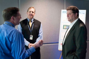 Discussion between Eric Toone, David Meyerhofer, and Sam Morse during visit