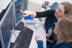 Carolyn Kuranz and Christine Krauland examining SOP (Streaked Optical Pyrometer diagnostic) data