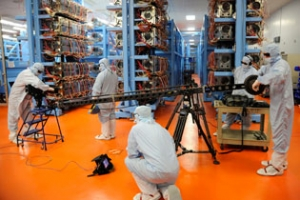 A crew from the Discovery Channel prepares to film in the OMEGA Laser Bay
