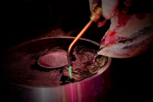 """Molten lead at 800°F is shown being """"puddled"""", a process originally used to make steel from pig iron"""