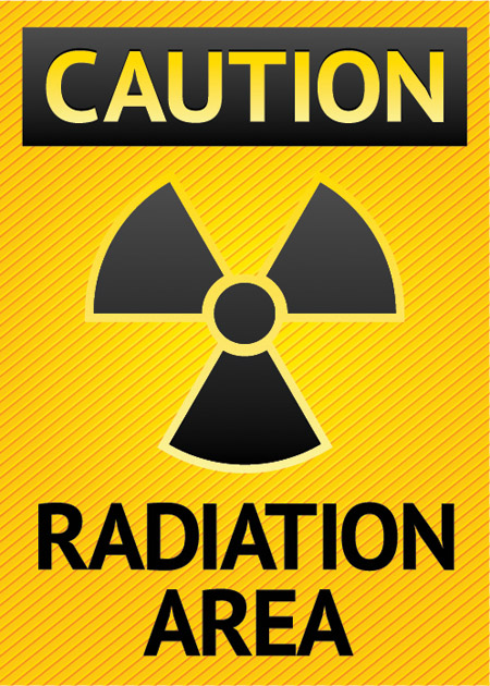 Caution Radiation Area sign, yellow background
