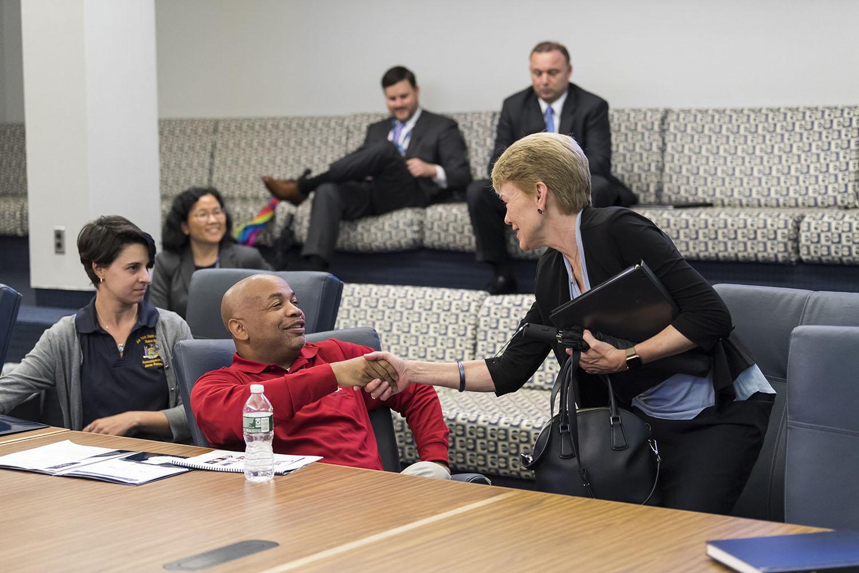 Carl Heastie is greeted by Sarah C. Mangelsdorf