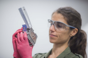 Federica Coppari holding an x-ray diffraction image plate