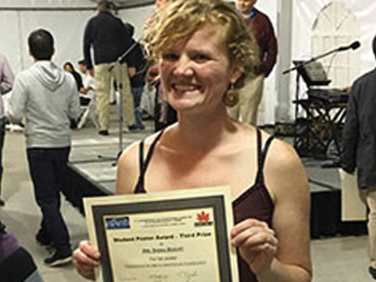 Sara Bucht holding Third Place Student Poster Competition at the 2016 ICUIL Conference
